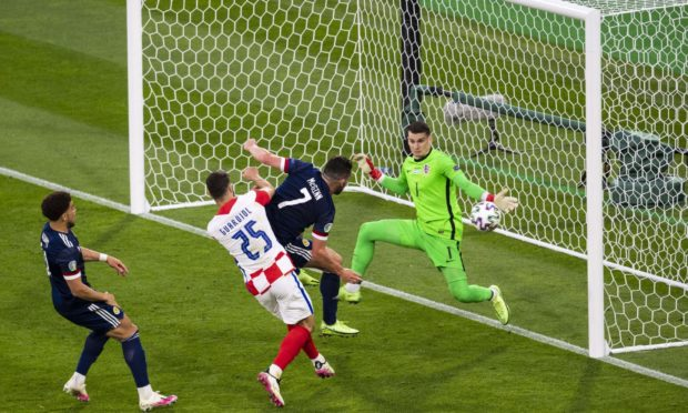 John McGinn came close to pulling a goal back for Scotland as they crashed out of Euro 2020 with defeat to Croatia