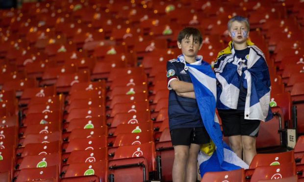 Two young fans watch on as Scotland make an early Euro 2020 exit but Rab Douglas is convinced they'll be back at a major finals soon