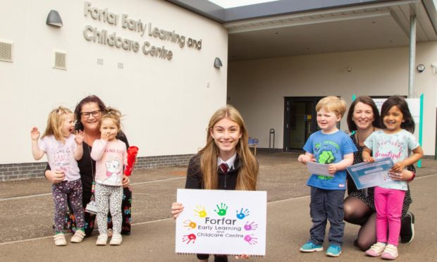 Laura with centre manager Paula Anderson (left), depute manager Lara Turriff and some of the children.