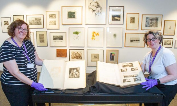 Angus Alive museums, galleries and archives lead Rachel Jackson and collections technician Jen Falconer at the Meffan.