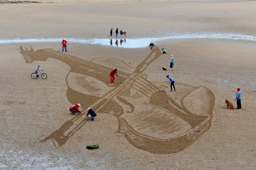 A violin drawn on the sand in East Neuk