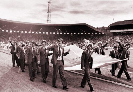 The Scotland squad perform a lap of honour around Hampden Park before flying to Argentina for the World Cup Finals.