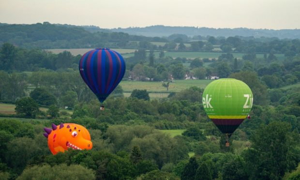 Balloonists take flight during the opening of the Midlands Air Festival in Alcester, Warwickshire. Picture date: Friday June 4, 2021. PA Photo. Photo credit should read: Jacob King/PA Wire