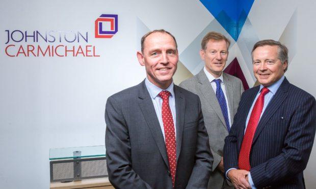 Johnston Carmichael image caption L-R: Andrew Walker, Andrew Shepherd, Sandy Manson  Handout from Big Partnership