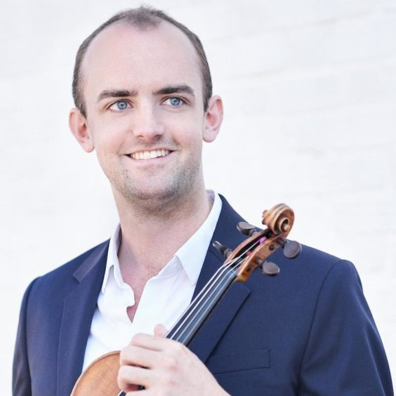 Benjamin Baker posing with his violin