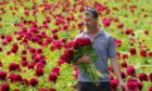 Production manager Jaun De Beer carries freshly cut peonies at the family-run Bury Lane Farm in Royston, Hertfordshire. Demand for the flower has grown by almost 100 percent in the last three years according to figures from supermarket Tesco. Picture date: Tuesday June 8, 2021. PA Photo. Supermarkey chain Tesco say peonies have soared in popularity in recent years and that the chilly and rainy spring has boosted the quality of this year's crop. See PA story CONSUMER Peonies. Photo credit should read: Joe Giddens/PA Wire