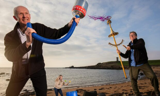 Richard Wemyss and Ellie Deas from the Cellardyke Sea Queen Festival join composer and instrument maker Graeme Leak play musical instruments made of beach rubbish