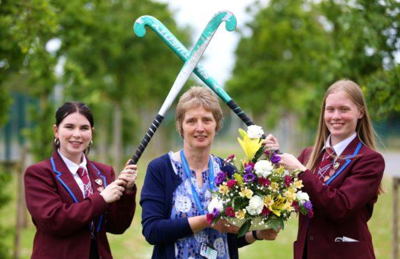 Anne Callander with Forfar Academy S6 pupils Rachel Wilson and Eilidh Troup.
