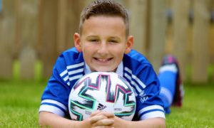 Josh Forrest with his strip and match ball from Scotland's European Championship opener.
