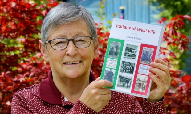 Norma Alari at her home in Cupar with her new book