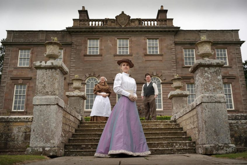 Members of the National Trust for Scotland team pictured in costume outside House of Dun.