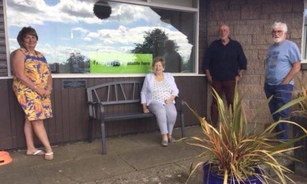 Freda Wells, Zena Nairn, Dave Ramsay and Ian Esplin with the Meadowbank Inn memorial bench to Johnny Mac.
