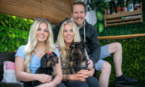 Runaway Dundee dog Stan is now back with and owners Jasmine and Emma Kettles.