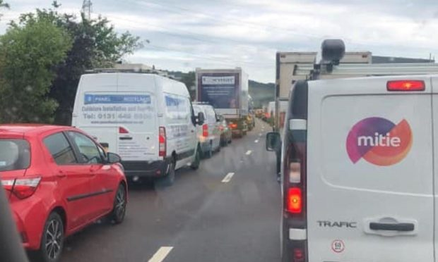 Long tailbacks formed for morning commuters following a two-car collision on the M90 near Halbeath.