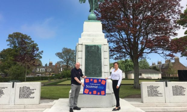 Jim Strachan of Poppy Scotland Montrose and Lynne Ogg of Scotmid at the Montrose cenotaph.
