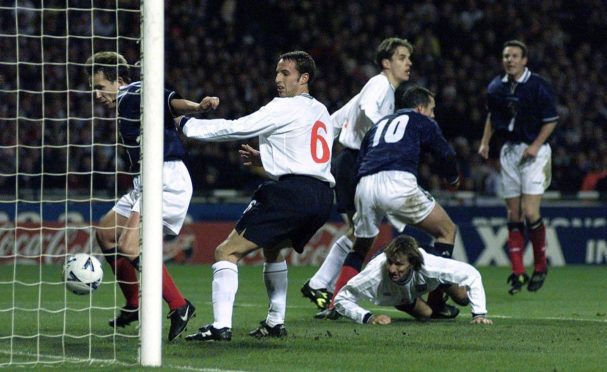 Scotland striker Don Hutchison celebrates his goal during a Wembley win in 1999