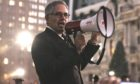 Larry Krasner with bullhorn at a rally in Philly DA.