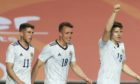 Scotland's Kevin Nisbet celebrates with  his team-mates after scoring.