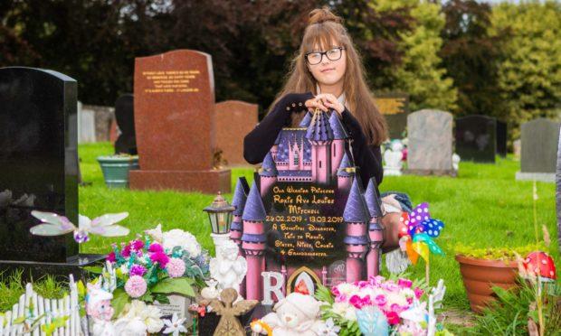 Natasha-Lee McGilligan at Roxie's grave.