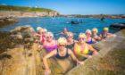 Members of the Menopausal Mermaids group enjoying the Pittenweem tidal pool.