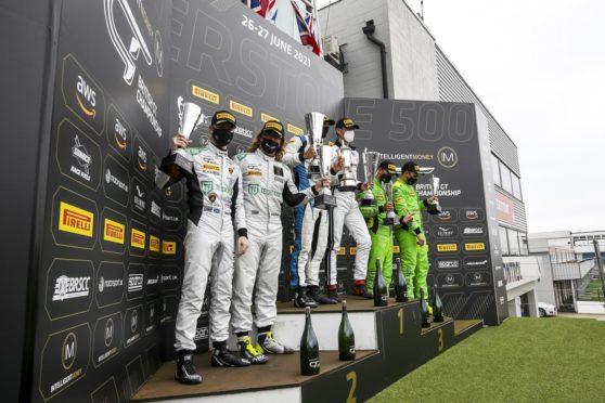 Sandy Mitchell (far left) on the Silverstone 500 podium.