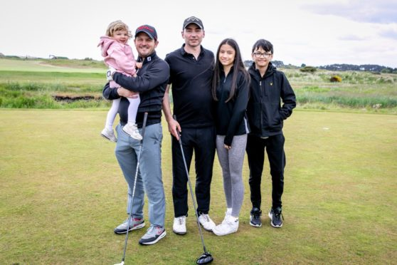 Iain Evans and two-year-old daughter, Rosie and David McFarlane with children Cara, 16, and Aidan, 12.