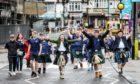 Fans arriving at Wembley Stadium ahead of England v Scotland.