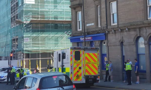 An ambulance on the scene at the Seagate and St Andrews Street junction.