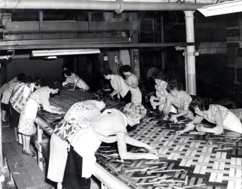 Women making inlaid linoleum, c.1960.