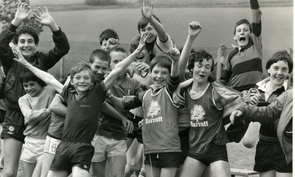 The boys of Whitfield Primary School grab the attention of the camera man as they take a break from the sports day action in June 1983.