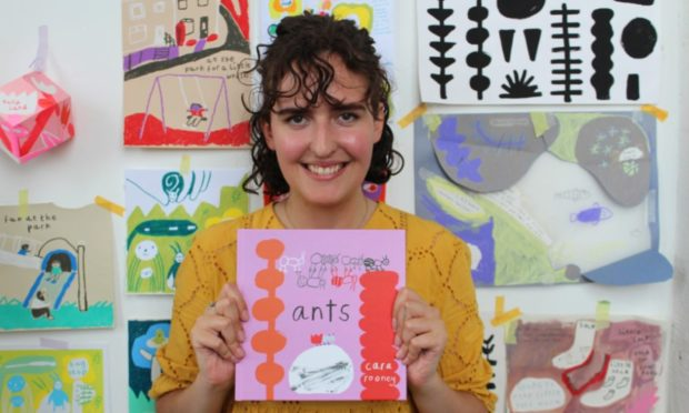 Cara Rooney holds her book Ants