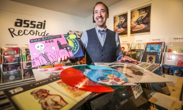 Assai record shop owner Keith Ingram with some of the records available for sale at the event last year, which was modified to take in Covid-19 restrictions.