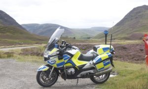 Police motorcycle on the A90