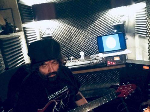 Liverpool songsmith Ian McNabb working in his studio.