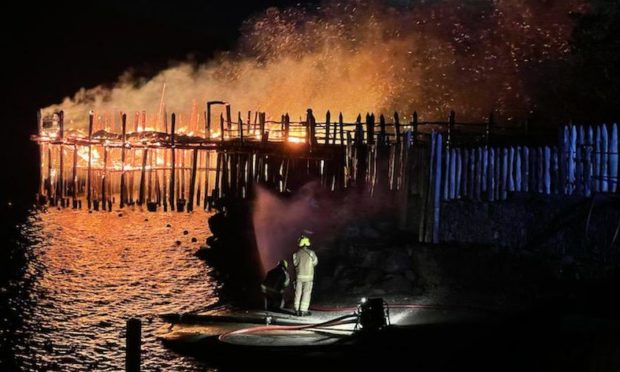 Firefighters at the scene of the fire at the Scottish Crannog Centre.