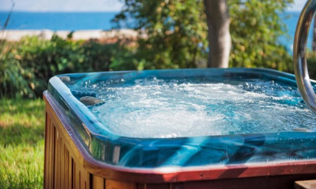 The alleged assaults happened in an outdoor hot tub