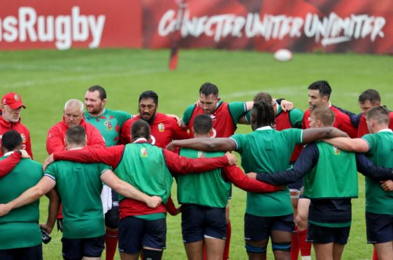 Head coach Warren Gatland leads a player huddle in Lions training this week.