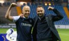Charlie Adam and James McPake celebrate following Dundee's play-off triumph.