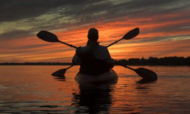 Kayakers enjoy the sunset on Cameron Lake, just off the Canada Trail near Fenelon Falls, Ont.,