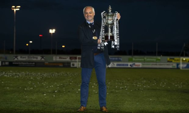 McKinnon with the League Two trophy