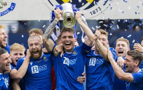 St Johnstone captain Jason Kerr lifts the Scottish Cup.