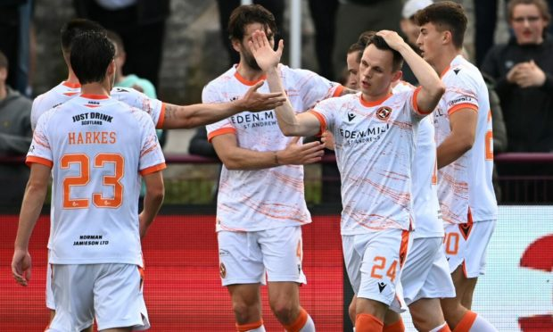 Dundee United striker Lawrence Shankland celebrates his goal against Kelty Hearts.