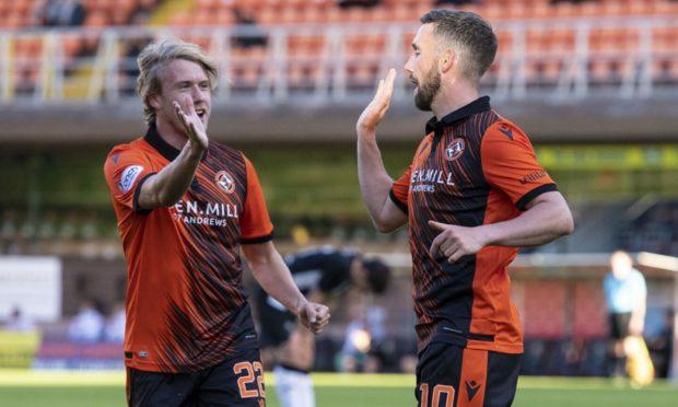 Nicky Clark (right) celebrates his goal with Kieran Freeman.
