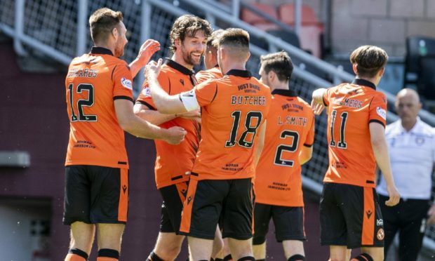 Charlie Mulgrew is congratulated by his team-mates for his first-half free-kick goal.