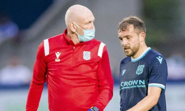 Dundee's Paul McMullan goes off with an injury during the Premier Sports Cup match between Montrose and Dundee.