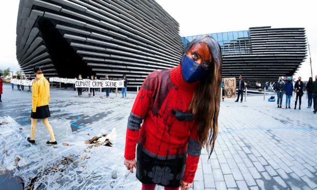 An Extinction Rebellion protestor outside the V&A