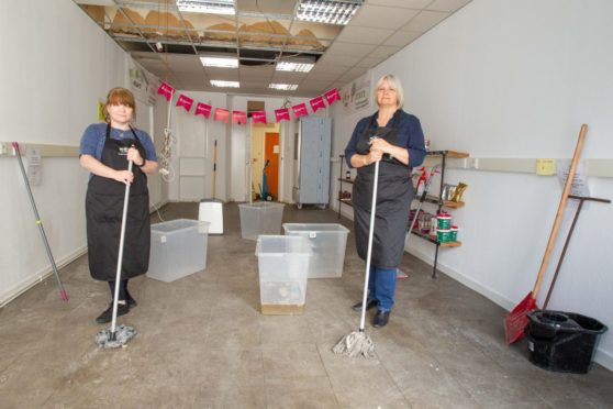 Carol Malone (left) and Pauline Lockhart in the S-Mart social supermarket which was swamped by a burst pipe. Pic: Paul Reid