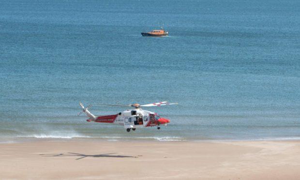 Montrose RNLI assist HM Coastguard at Lunan Bay.