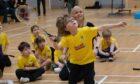 Racquet Buddies teaches children badminton and tennis skills.