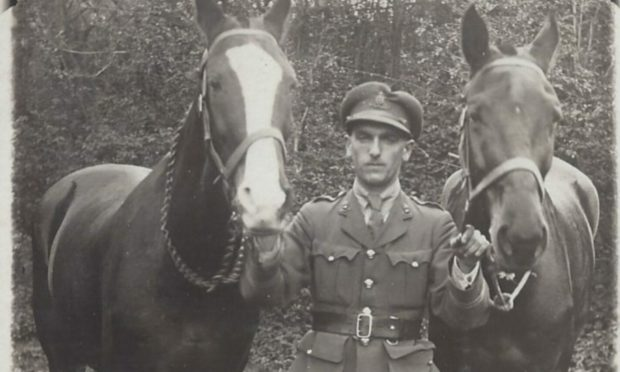 Captain Alexander Wallace with his distinctive chestnut and white mare, Vic, and another war horse. Supplied by Montrose Air Station Heritage Centre.
